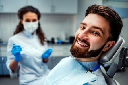 man with beard in dental chair