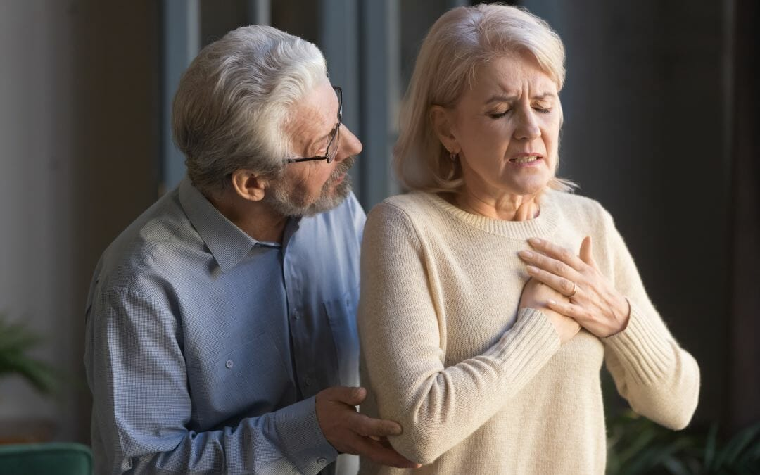 older woman hands on chest
