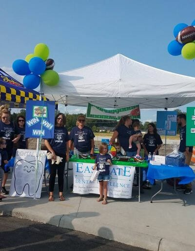 Eastgate Dental Excellence team booth at community service event